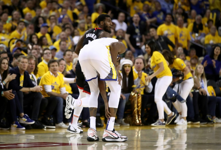 7208c41ea57 Kevin Durant of the Golden State Warriors grabs his right leg after  injuring himself against the Houston Rockets during game five of their best  of seven ...